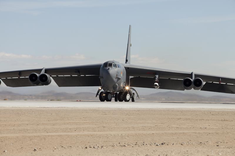 X-51 Waverider shown under the wing of the Air Force Flight Test Center B-52H as the aircraft takes the runway at Edwards AFB, CA. on 26 Mary 2010. USAF photo by Greg L. Davis.